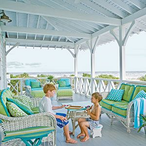 I love this porch and the blues and greens for a beach house. Beautiful colors. Preppy Decorating Ideas | Portrait of Paradise | CoastalLiving.com