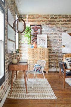 Exposed brick, card catalog and some gorgeous mid century furniture.  This room has the makings of heaven.