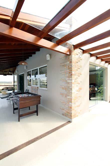 ESPAÇO FAMÍLIA: Garagens e edículas rústicas por Graça Brenner Arquitetura e Interiores