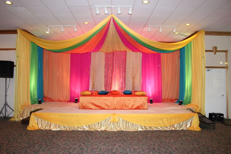 Mehndi Flower Canopy : Colorful backdrop with canopy in yellow green hot pink