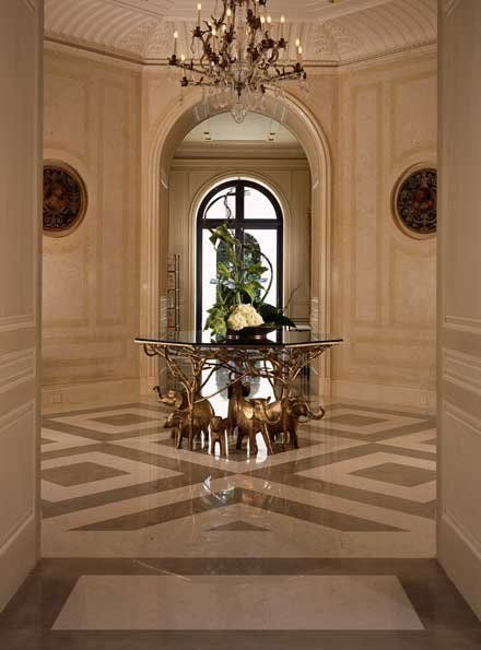 Beautiful entry with hand painted paneling. What a foyer!