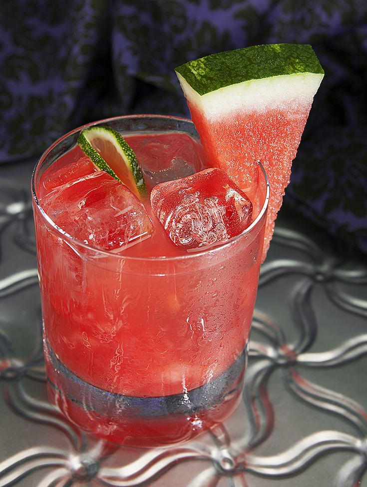 Watermelon Margarita - Rocks.  Ingredients: 1.5 oz. top self tequila .5 oz. cointreau .5 oz. agave nectar juice from ½ lime 4 cubes of fresh watermelon Preparation  In a shaker, muddle watermelon and lime juice, add remaining ingredients plus a cup of ice. Shake for about 10 seconds. Strain contents into a glass filled with ice and enjoy!