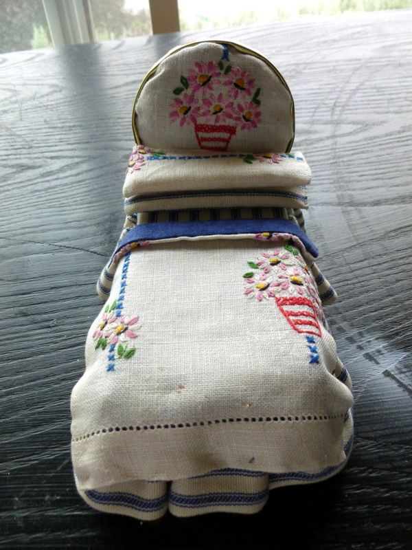 Bed made with vintage tea towel fabric and a jar lid headboard.  Sold.
