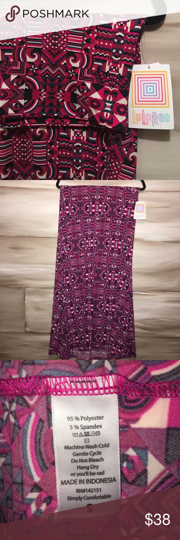 Lularoe Maxi Skirt Cool, slinky fabric! Unique designs made up of reds, pinks, black, ivory and dark marine blue! LuLaRoe Skirts Maxi