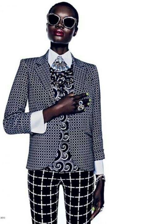 Mixing patterns! Grid print trousers + circle print jacket + swirl print jumper, all in black and white.
