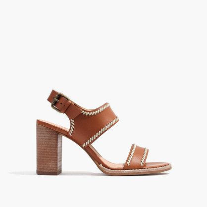 Rich leather sandals with artful contrast stitching inspired by a vintage  '70s bag. With