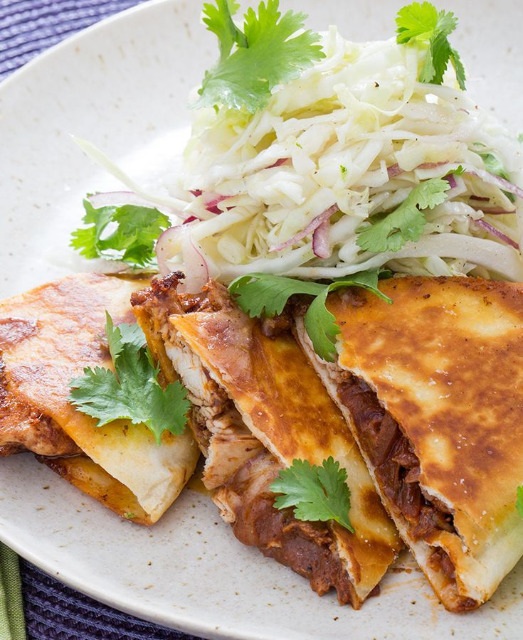 Tomatoes, herbs, spices and unsweetened chocolate combine to create a savory sauce for these classic quesadillas.