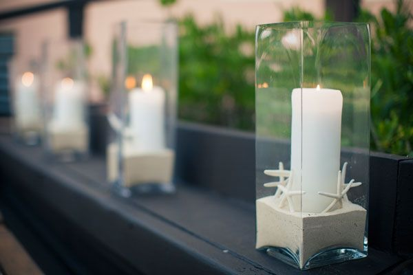 Rent large square vases for wedding centerpieces.