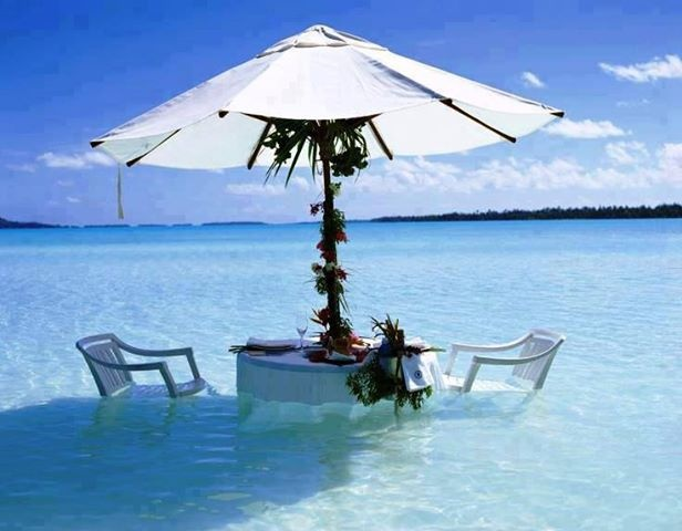 Dining in the water - Bora Bora.  Go to www.YourTravelVideos.com or just click on photo for home videos and much more on sites like this.
