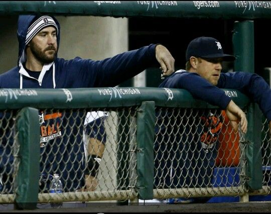 Justin Verlander drops sunflower seeds into the hood of  Bryan Holaday.