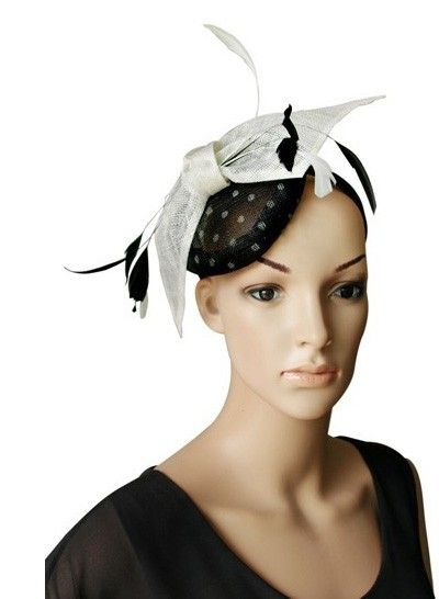 """""""Coccinelle"""" Black and White Fascinator. A beautiful full well-rounded design available in a lovely selection of colours, Sitting atop a matching satin headband, the half rounded sinamay cap features gorgeous polkadots, a large sinamay bow and finished with a spray of feathers. $69.95 including gift box and FREE shipping in Australia."""