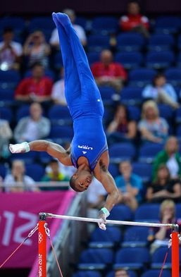 John Orozco, member of USA Gymnastics men's Olympic team, competes on the high bar during qualifications in London.