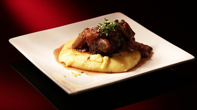 Oven Baked Lamb Shank on Soft Polenta Topped with Gremolata