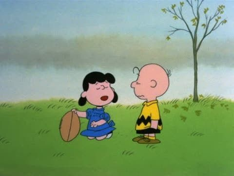 "A Charlie Brown Thanksgiving - Opening. Watch and hear Charlie and Lucy. Charlie reluctantly agrees to kick the football. After he swings and misses? ""Lucy"" says ""Isn't it peculiar Charlie Brown how some traditions fade away?"" NOTE: Cartoonist and creator of the comic strip ""Peanuts""  Charles Schultz, born Nov. 26, 1922 & ""Peanuts"" (Snoopy) is on a US Postal stamp: http://s.si.edu/1hdUWlR"