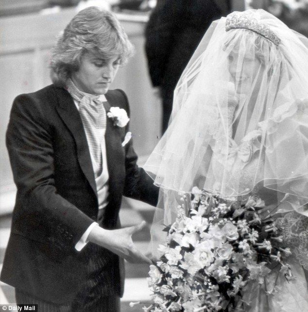 Dressmaker: David Emanuel applying the finishing touches to Princess Diana¿s dress at her wedding in St Paul's Cathedral in 1981