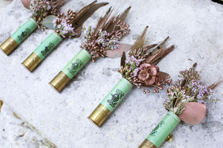 Rustic boho wedding, shotgun shell boutonnieres, feathers, rose-gold painted flowers