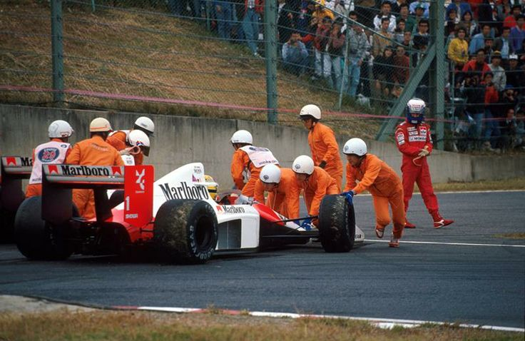 After their collision, Alain Prost (FRA) walks away believing he had just won the World Championship. However Ayrton Senna (BRA) had other ideas, and insisted his McLaren MP4/5 be push started. Japanese Grand Prix, Suzuka, Japan. 22 Oct 1989