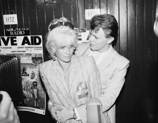 David Bowie backstage at the Live Aid conncert with TV presenter and wife of Bob Geldof, Paula Yates in 1985 [Getty Images]