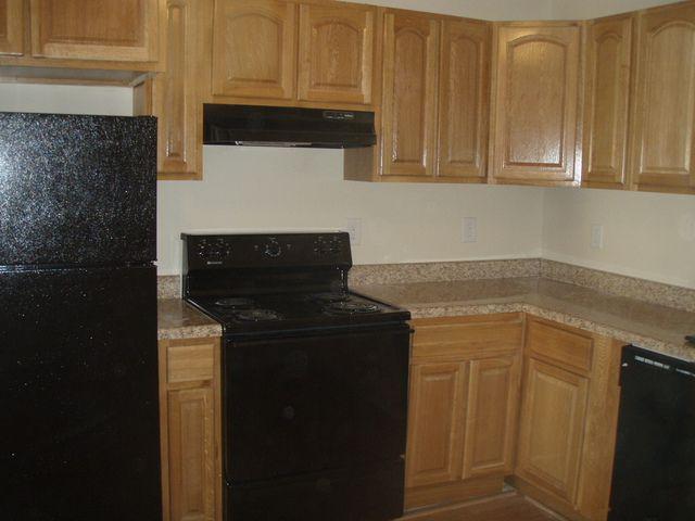 White Kitchens With Black Appliances