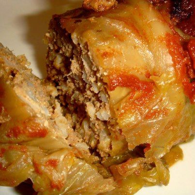 OVEN BAKED CABBAGE ROLLS: 12 cabbage leaves 1 pound ground beef 3/4 cup cooked rice 1/2 cup finely chopped onion 2 cloves garlic, minced 1 egg 2 teaspoons salt 1 teaspoon pepper  1/2 cup milk  Sauce: 1 cans (8 ounces ) tomato sauce 1 can (14.5 ounces) diced tomatoes, undrained 3 tablespoons sugar 2 tablespoons vinegar 1/2 cup water 2 tablespoons cornstarch mixed with 1/4 cup cold water