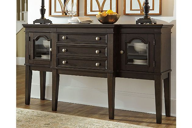 With its beautiful breakfront design, arched framed glass doors and craftsman-style knobs with hammered effect, the Alexee server is timeless charm, brilliantly served. Adjustable shelved storage and a trio of drawers for silverware and utensils make it abundantly practical.