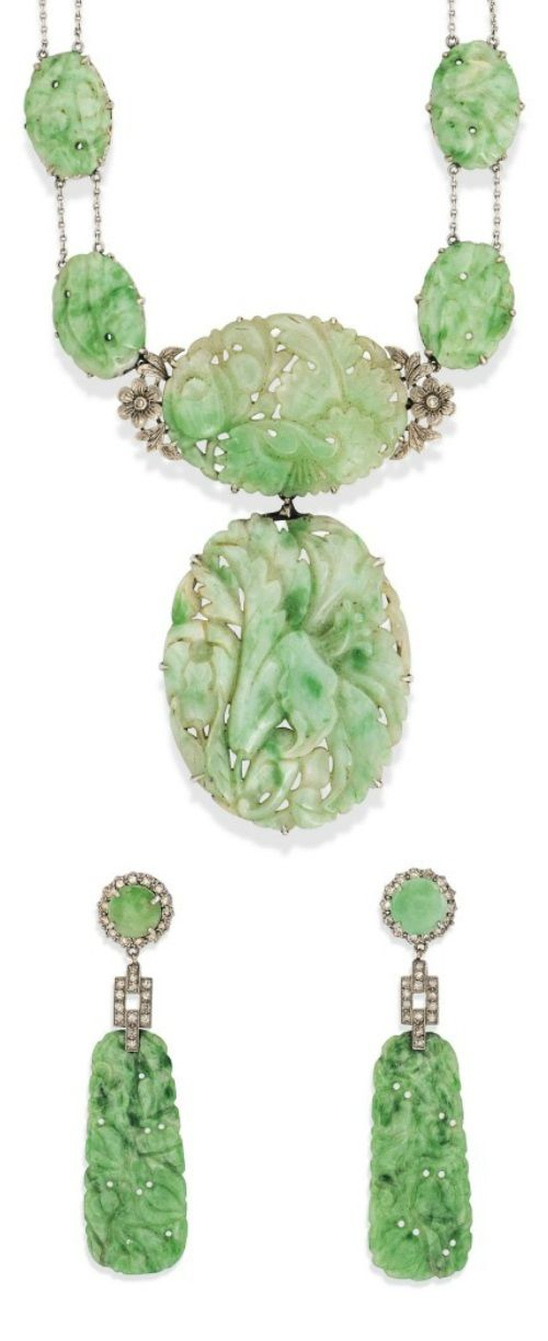 AN ART DECO JADEITE JADE NECKLACE AND A PAIR OF EARRINGS. Of stylised carved floral design. #ArtDeco