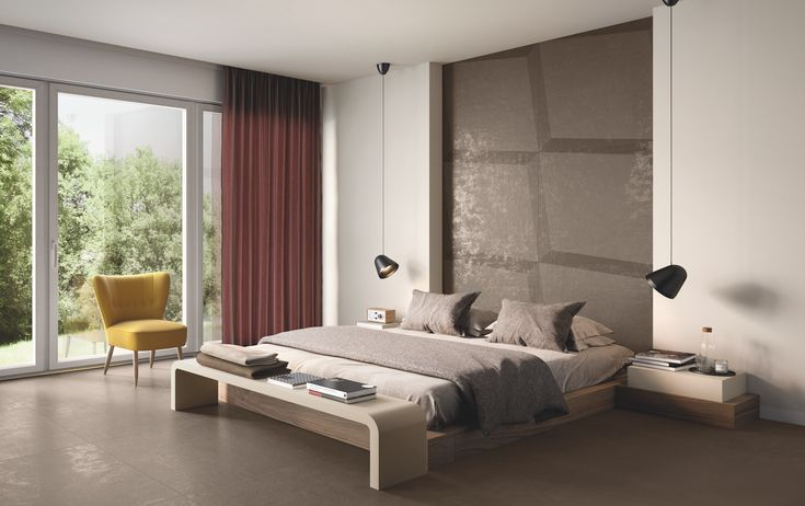 """The result of a collaboration between the designer Marco Piva and Casalgrande Padana, Shades is a sophisticated decorative process that takes inspiration from """"material design"""" and applies this to ceramics, enhancing the Black, Grey and Tobacco colours of the Resina collection."""
