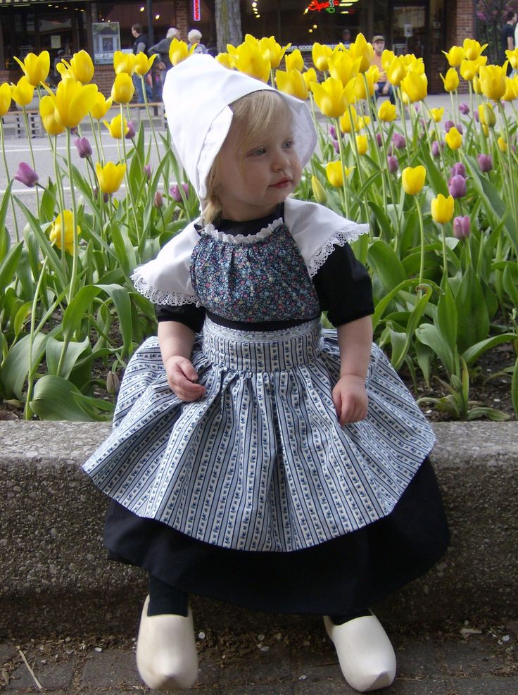 Dutch flower girl outfit complete with wooden shoes. [I love your pins and I adore this little girl and her dress, bonnet and the wooden shoes. thanks for sharing and welcome to my pins. I love the tulips too. Just beautiful.].......Guynell Franks