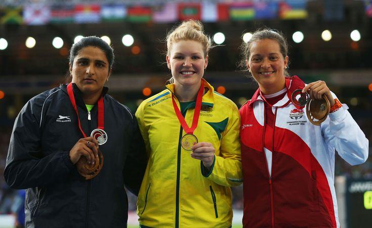 L-R) Silver medallist Seema Punia of India, gold medallist Dani Samuels of Australia and bronze medallist Jade Lally of England
