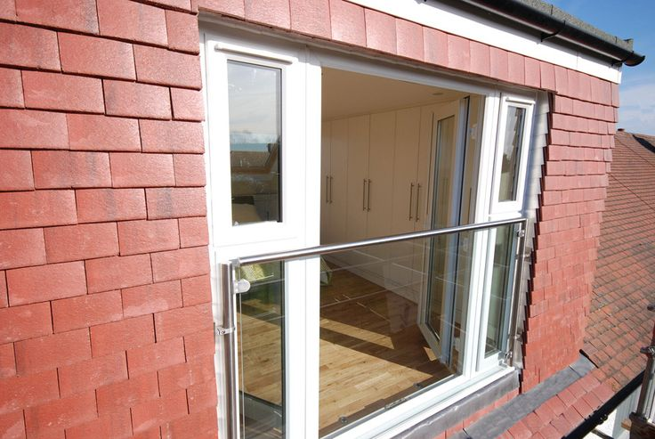 glass balustrade and frenh doors to a rear dormer loft conversion in east london