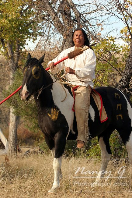 | Native American Indian man sitting on a war painted horse portrait ...