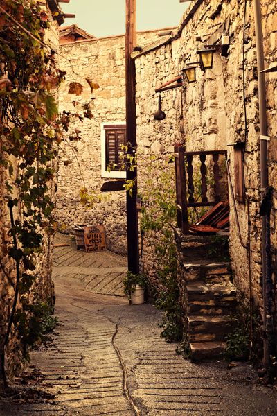 Tiny alleyway in the mountain village of Omodos, Cyprus. Fine art print by Around the Island Photography.