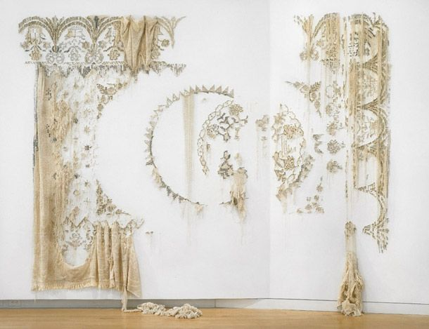 beautiful work by Elana Herzog, New York. Textiles staped to the wall and slowly deconstructed thread by thread.