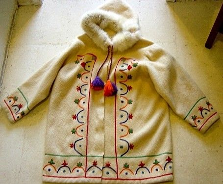 White Wool Eskimo Jacket with Real Fur on Hood and multi-coloured handmade embroidered stitching. Made in Canada.