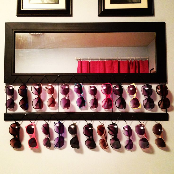 Made my mirror into a Pinterest inspired DIY sunglasses holder! Now I have an organized way to display all of my sunglasses. All you need is some ribbon and thumbtacks!