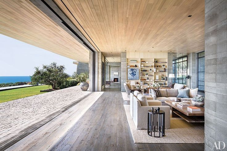 The spacious living room is separated into two intimate sitting areas and has panoramic views of the glistening ocean.