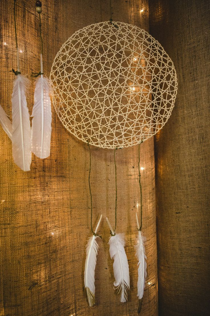 Camp Circa. Circa Lighting's Holiday Party 2013.  Design was inspired by the great outdoors and all things camp(y). Design by Rethink Design Studio | Savannah, GA | Joel Snayd  DIY dream catchers using IKEA placemats, white feathers w/ painted gold tips and some simple twine. Burlap and white lights create a nice backdrop and room divider.