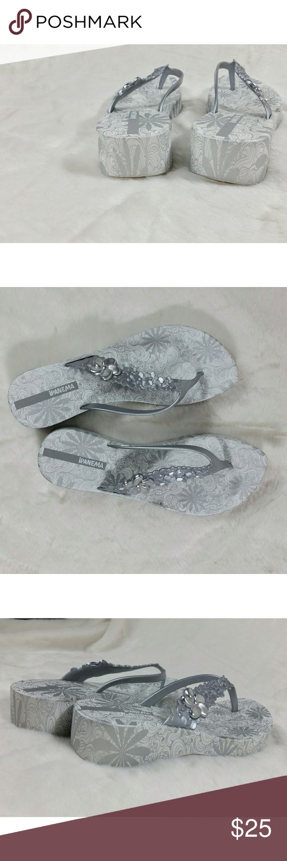 Ipanema Gray White Wedge Flip Flops Slippers 9 Very substantial slippers.  Feels like rubber. Heavy. There are air vents (holes) in the soles for comfort. Pre-owned in excellent condition. Island vibe with the plumeria strap design. SIZE 9 Ipanema Shoes Slippers