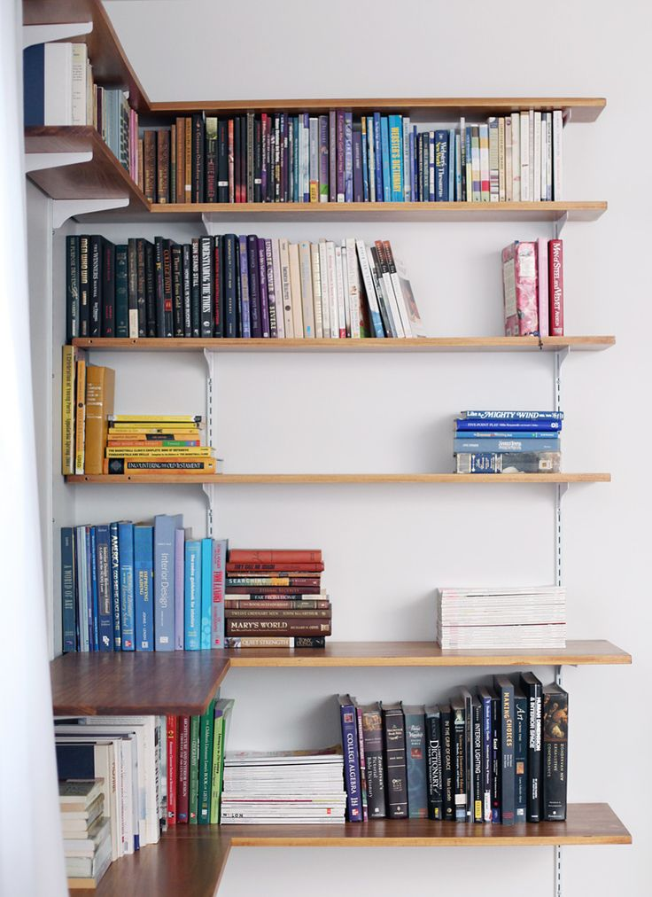 It's pretty simple to build your own shelving system. Click through for instructions and styling tips! (Idea for corner shelving for storing all of our movies!)