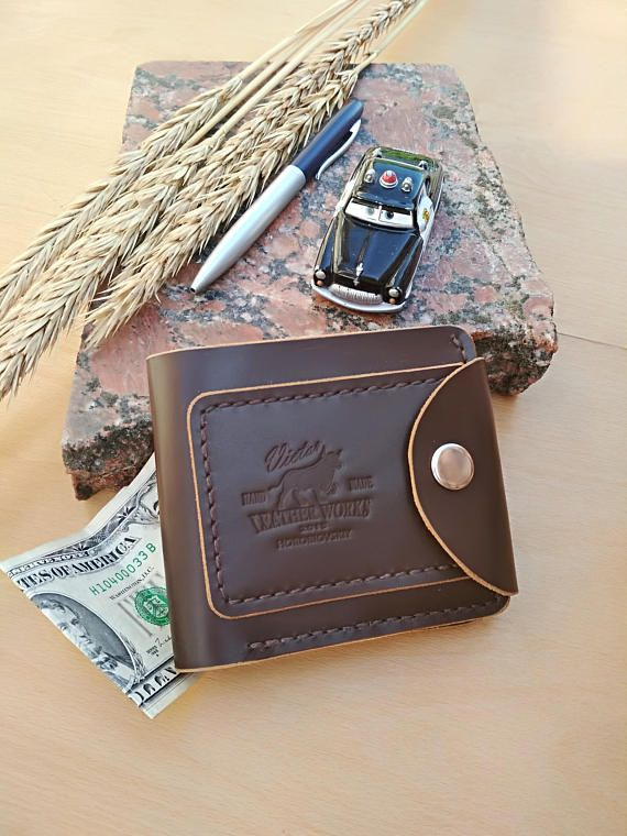 Handmade Valentine's Day Gift Idea for Men! This handmade leather wallet makes a wonderful, quality handmade Valentine's Day gift for him! Handcrafted from high grade leather, this billfold wallet is compact and practical and has a steel button closure. #giftsformen #giftsforhim #giftsfordad #valentinesdaygift #valentinesdaygiftidea #wallet #billfold #leather #leathercraft #gifts #giftideas #handmade #artisan #ad