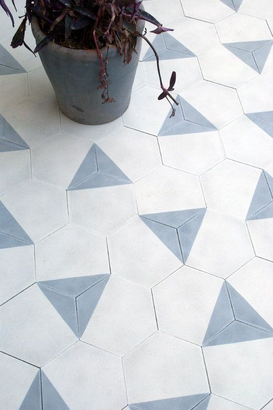 Amazing tiles - hexagonal blue and white tile floor. you could do different patterns with these!