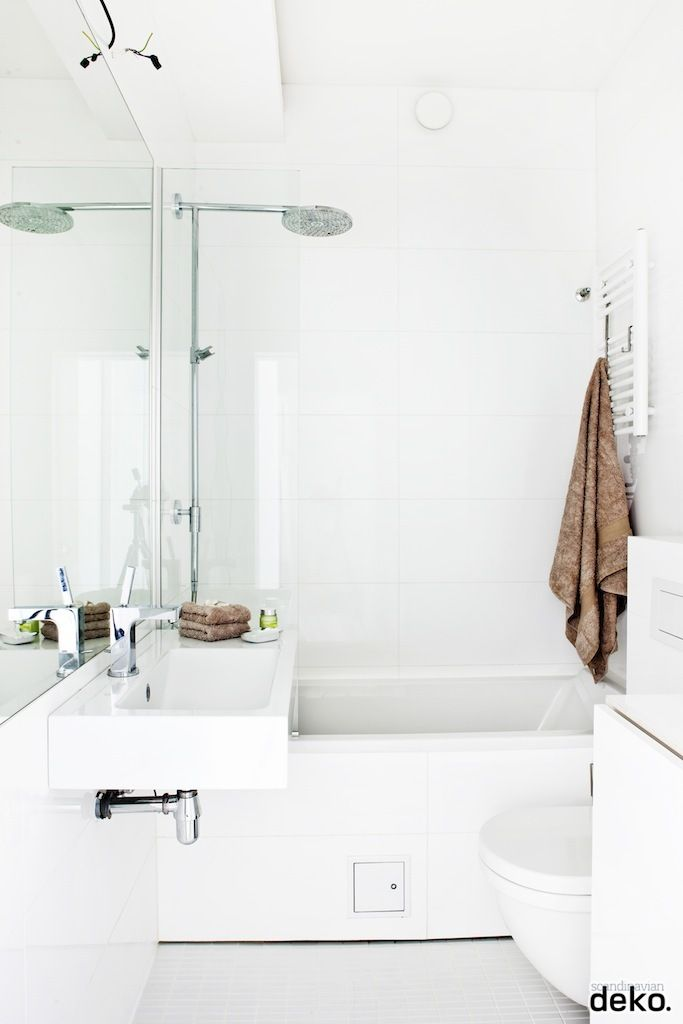 I love all white bathrooms. Not too fond of this one but the idea is good :)