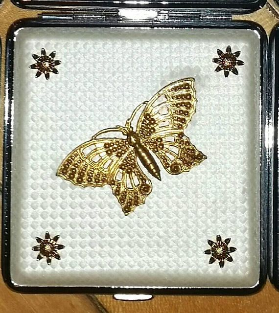 Check out this item in my Etsy shop https://www.etsy.com/ca/listing/583838536/art-nouveau-butterfly-cigarette-case