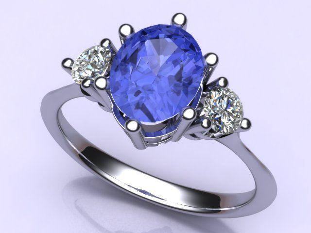 Pretty tanzanite ring, accented by diamonds, in 10k white gold. #ArtofGems