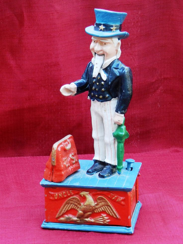 Vintage Uncle Sam Cast Iron Working Mechanical Bank       00549 by NWAttic on Etsy https://www.etsy.com/listing/248506005/vintage-uncle-sam-cast-iron-working
