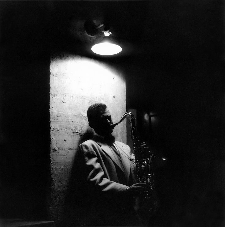 Stan Getz playing by the stage door in Cosmo Alley, Hollywood, 1954, photo by William Claxton