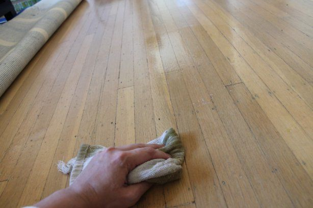 cleaning with DIY floor polish.  This works for laminate floors also, just put a fan on them to help dry quicker. Look nicely polished along with being cheaper and clean on your lungs :)