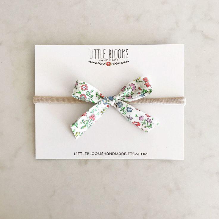 Fabric Bow - Liberty of London - nylon headband or hair clip by LittleBloomsHandmade on Etsy https://www.etsy.com/listing/515798565/fabric-bow-liberty-of-london-nylon