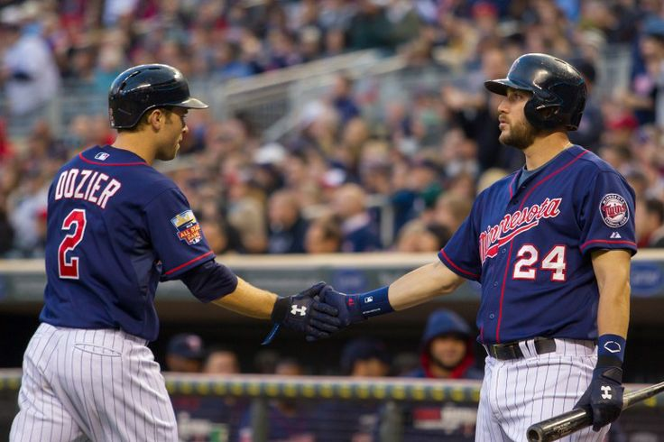 May 13, 2014; Minneapolis, MN, USA; Minnesota Twins third baseman Trevor Plouffe (24) congratulates second baseman Brian Dozier (2) after he scores in the second inning against the Boston Red Sox at Target Field. Mandatory Credit: Brad Rempel-USA TODAY Sports