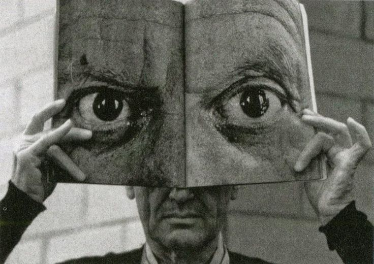 """hauntedbystorytelling: """" Ingeborg Morath :: Charles Eames posing with a Book 'Mask' of Picasso's Eyes, 1959 more [+] by this photographer """""""